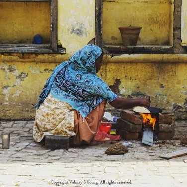 Lady cooking our chapati's in a Punjabi village near Amritsar