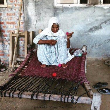 104 year old woman recycling wool in a Punjabi village near Amritsar