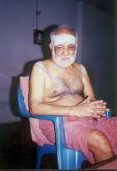 Swamigal accepting a devotee's namaskaram