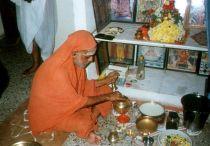 Swamigal performing puja
