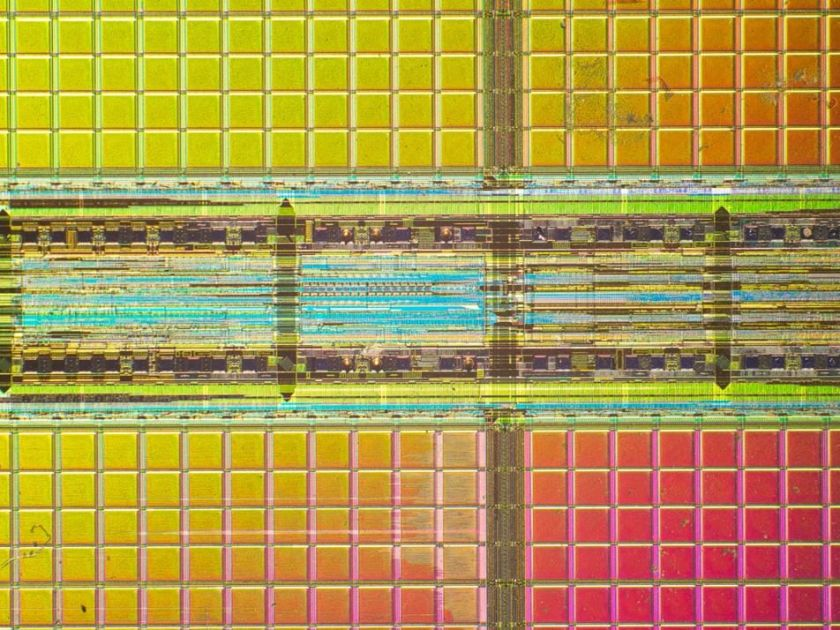 close-up photo of a microchip in yellow and red tones