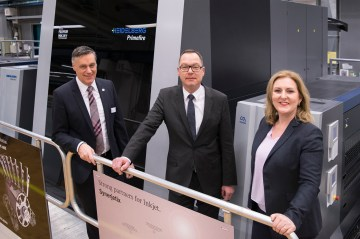 From left: Thomas Heissler, Global Account Manager Heidelberg, Götz Schümann, General Manager MPS Produktion Oberslum, Montserrat Peidro-Insa, Head of Digital Sales and General Manager Digital Sheetfed Heidelberg in front of Primefire 106. Photo: Heidelberg