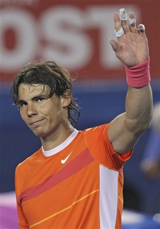 Rafael Nadal of Spain waves after beating Australia's Peter Luczak during their Men's singles first round match at the Australian Open tennis championship in Melbourne, Australia Monday, Jan. 18, 2010.   (AP Photo/Mark Baker)