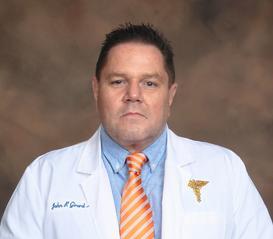 John P. Girard, MD