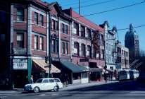 CVA 780-16 - [Buildings and businesses in the] 300 [block] W[est] Pender [Street] - north side . Taken between 1960-80. I would guesstimate that this was taken in the late 1960s. Visible in this photo are MacLeod's Books (at an earlier location at northeast corner of Pender at Homer; it is located today at northeast corner Pender at Richards) and the People's Cooperative Bookshop which is located today on Commercial Drive).