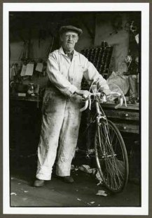 "VPL 88617 ""Man with bicycle in workshop"" Nina Raginsky. 1972."