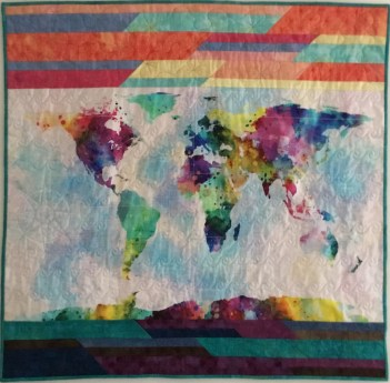 """""""Everyone has A story"""" - 40"""" panel map is hand quilted and the top and bottom strips are machine quilted."""
