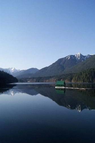 Reflection of the mountains in Capilano Lake at the Cleveland Dam