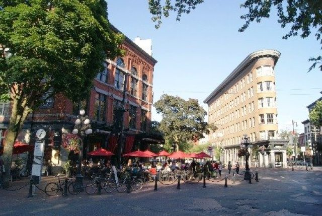 Buildings and sidewalk cafe on Water Street in Gastown