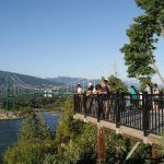 People admiring the Lions Gate Bridge from the Prospect Point Lookout at Stanley Park