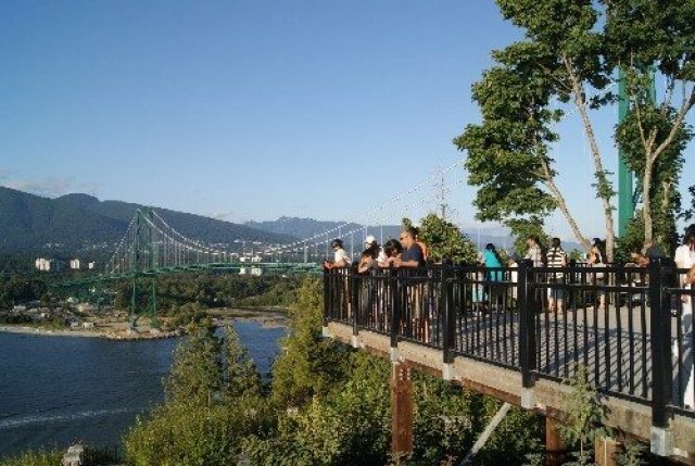 People admiring the Lions Gate Bridge from Stanley Park's Prospect Point