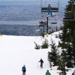 """Grouse Mountain chair above """"The Cut"""" overlooking the City of Vancouver"""