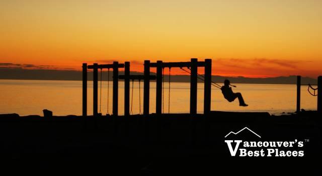 Child on Swing Sunset