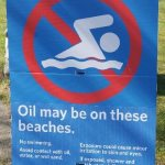 Oil on beach sign at Ambleside