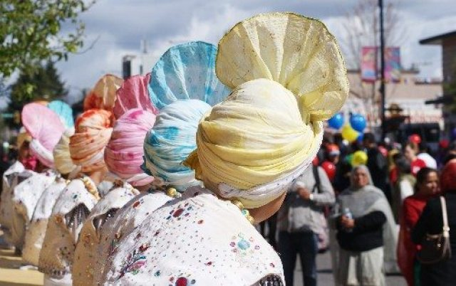 Row of East Indian Boys with Colourful Hats