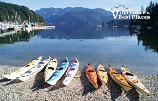Row of Kayaks in Deep Cove