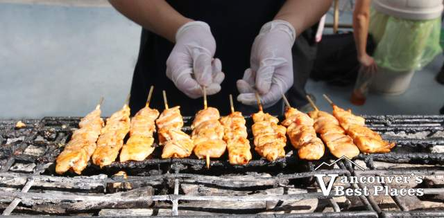 Japanese Yakitori at Cooking on a Grill
