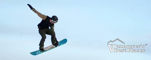 Snowboarder Jumping Through the Air