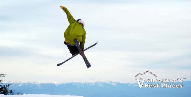Snowboarder in Air at Grouse Mountain