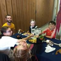 Kids at Gryffindor house table in Great Hall