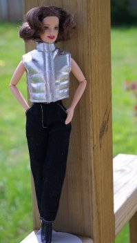 Juliet in the black jeans and sleeveless vest.