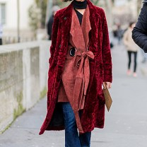 PARIS, FRANCE - MARCH 08: Yasmin Sewell is wearing a red fur coat and a red leather coat from Joseph and navy denim jeans outside Ellery during the Paris Fashion Week Womenswear Fall/Winter 2016/2017 on March 8, 2016 in Paris, France. (Photo by Christian Vierig/Getty Images)