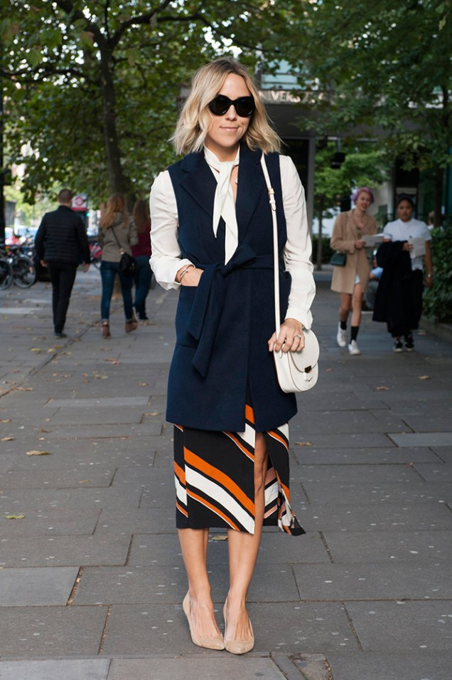 07-long-navy-vest-white-blouse-striped-skirt-street-style