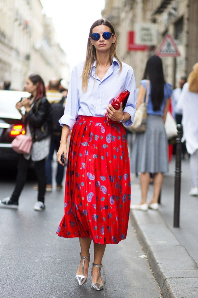 le-fashion-blog-street-style-sunglasses-blue-button-down-shirt-clutch-bright-red-printed-midi-skirt-with-pleats-metallic-silver-heels-via-harpers-bazaar