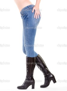 Woman legs in boots isolated on white
