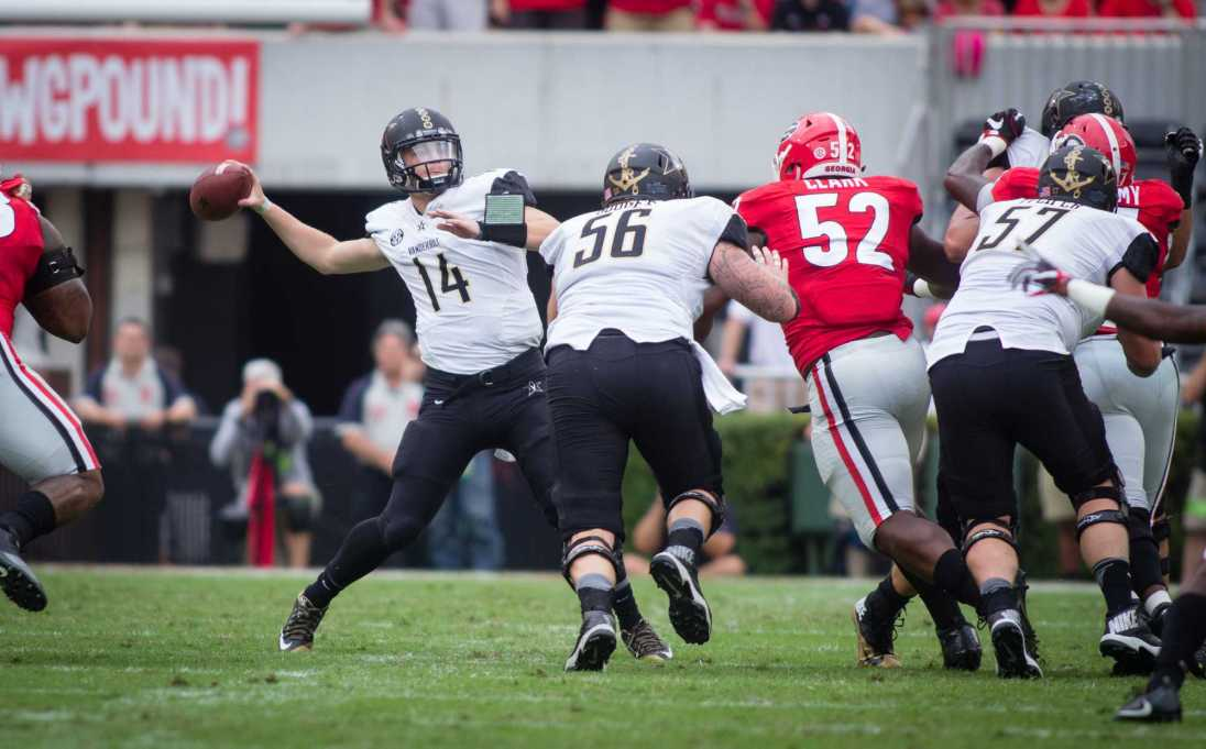 October 15th, 2016 – Kyle Shurmer passes during the Commodores' 17-16 win against the University of Georgia in Sanford Stadium Saturday afternoon.