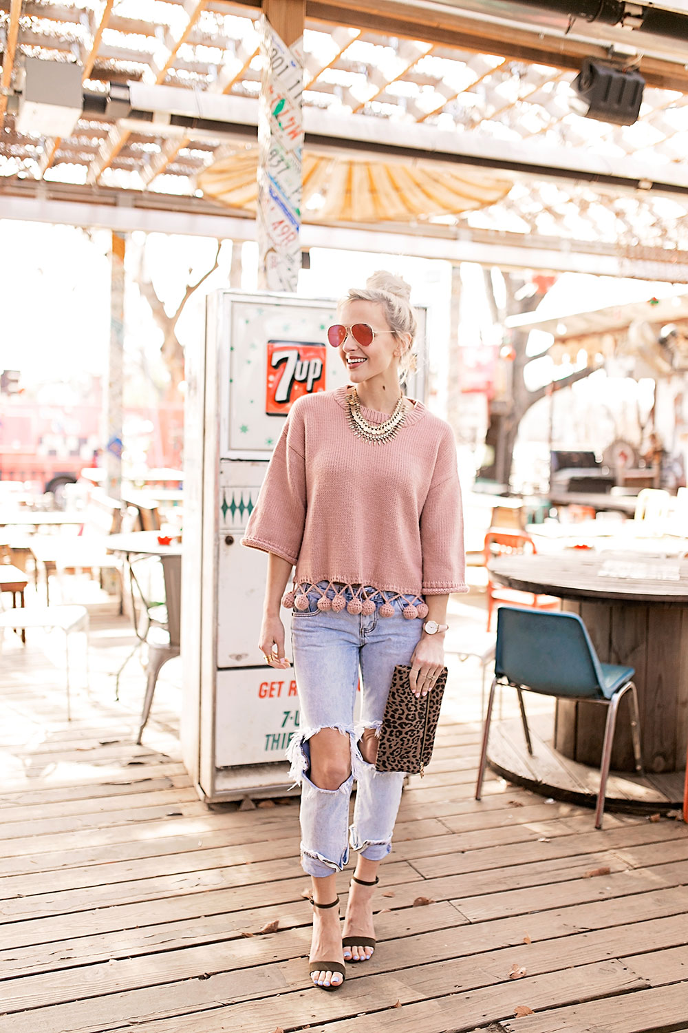 blush-pom-sweater-ripped-boyfriend-jeans-outfit