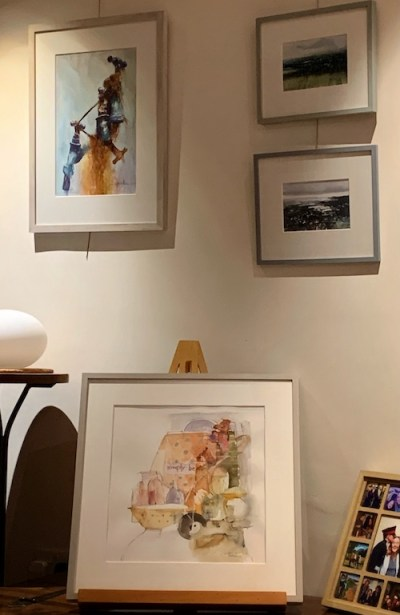 Stacked display paintings by David Poxon, David Parfitt and Shirley Trevenna