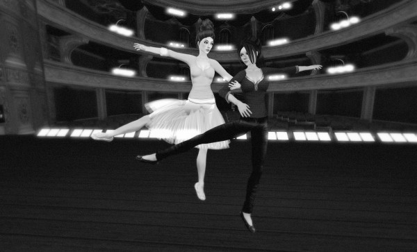 Black-and-white photograph from the Royal Opera House stage looking out toward the house. Agnes Sharple and Vanessa Blaylock, as Margot Fonteyn and Rudolf Nureyev, perform a partner dance.