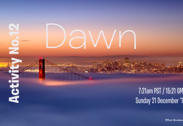 dawn over a fog laden Golden Gate Bridge