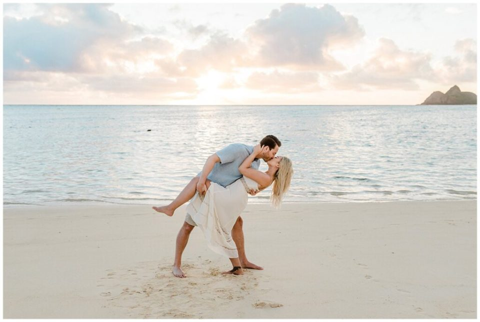 couple kiss at engagement session at beach in hawaii- vanessa hicks photography