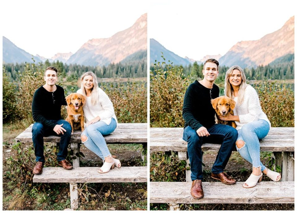 couple posing with their dog