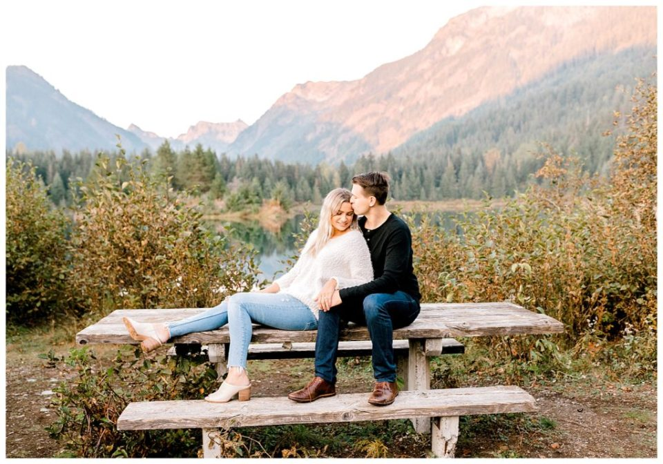 couple on a bench for engagement photos