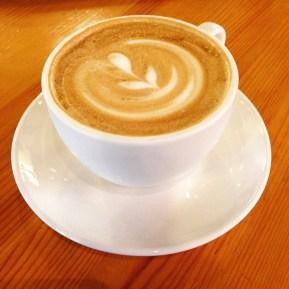 Enjoying a latte on a rainy day.