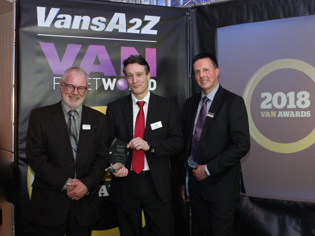 Iain Brooks picks up the award for Best Small Van, with Neil McIntee (left) and Dan Gilkes (right)
