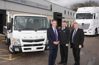 Sparshatts' dealer principal Steve Rooney (right) pictured with his brother Paul (centre) and financial director Peter Davies.