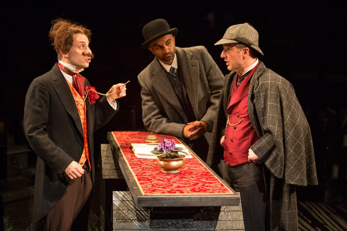 (from left) Blake Segal as Castilian Desk Clerk, Usman Ally as Doctor Watson, and Euan Morton as Sherlock Holmes in Ken Ludwig's Baskerville: A Sherlock Holmes Mystery, directed by Josh Rhodes, July 24 - Aug. 30, 2015 at The Old Globe. Photo by Jim Cox.