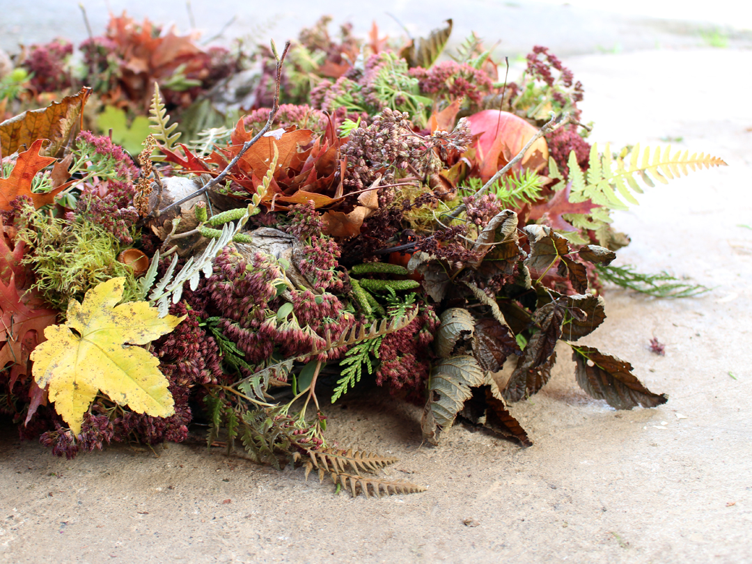 A naturally textured fall wreath foraged from wildflowers and plants.