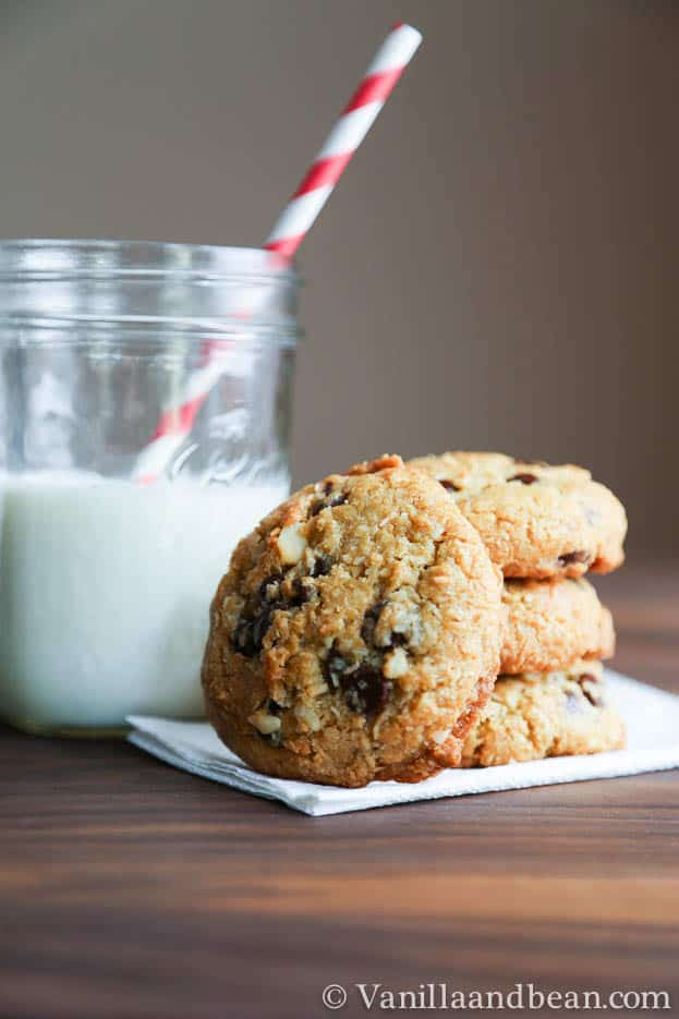 Coconut Macadamia Nut Chocolate Chip Cookies stacked and served with milk