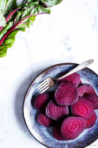 The beets sliced into thin discs ready for sharing.
