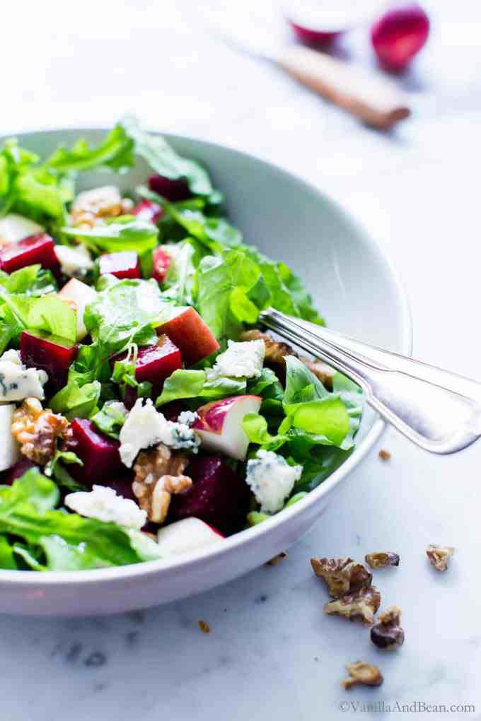 Nourishing fall flavors come together in this simple yet flavor packed salad. With a snappy dressing,Beet and Apple Salad with Apple Cider Vinaigrette is versatile enough to pull together with your favorite greens. | #VegetarianSalad #Vegan Option #GlutenFree