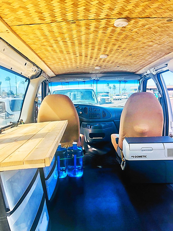 interior vanlife maui cloud 9 campervan with counter wooden table drawers camping gear 9 gallons drinking water refrigerator 12volt tiki theme