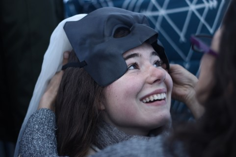 Danielle fits my Batman veil onto my head before the wedding. ANTONY PAGE