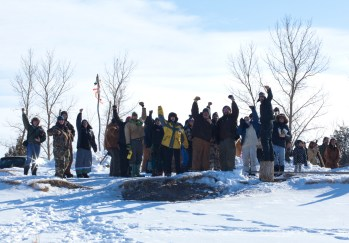 "Our friends shout ""Mni Wiconi!"" on the river bank after the ceremony finishes. JOHN WATHEN"