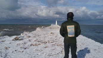 Alex watches the rough waves on a windy day at Sodus Point. FAITH MECKLEY