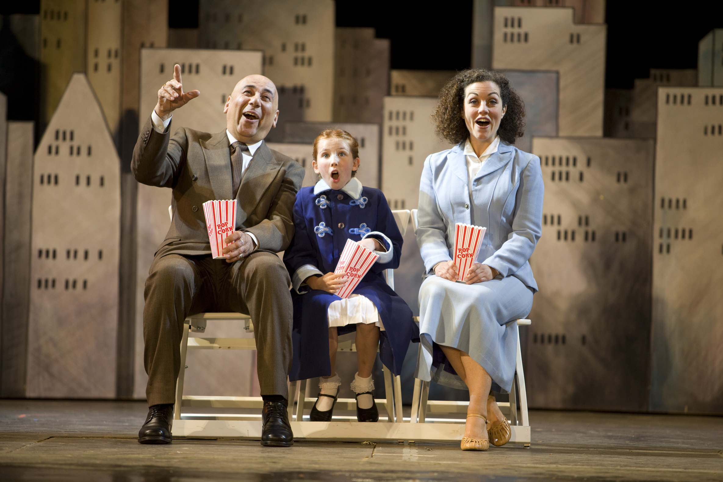 David Adams, Michelle Creber, and Dana Luccock in TUTS' production of Annie.  Photo by Tim Matheson